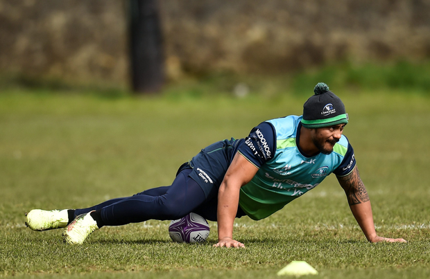 Pita Ahki gets his stretching done. Photo: SPORTSFILE