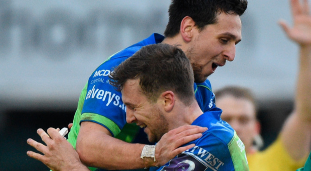 Jack Carty is congratulated by James Mitchell after scoring Connacht's second try against Brive last December. Photo: Sportsfile