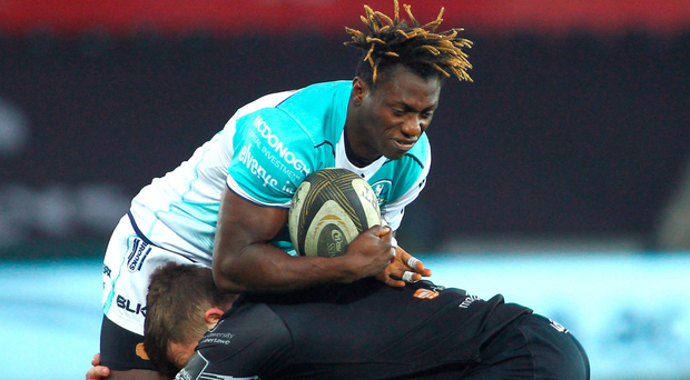 Niyi Adeolokun is tackled by Ospreys' Scott Otten during last week's defeat at the Liberty Stadium. Photo: Ben Evans/Sportsfile