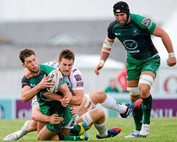 John Muldoon is ready to offer support as Craig Ronaldson is tackled during a Celtic League clash against Ospreys in the 2013-14 season. Photo: Sportsfile
