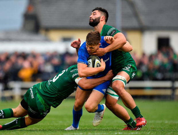 Colby Fainga'a and team-mate Tom Farrell getting to grips with Leinster's Garry Ringrose. Photo: Sportsfile