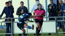 Referee Jason Cairns keeps a close eye on the action