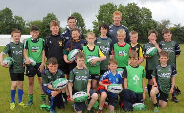 Some of the Carrick on Shannon youngsters have their photos taken during the Connacht Summer Camp with the province's players John Cooney and Daragh Leader