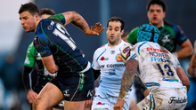 Robbie Henshaw, Connacht, passes behind his back despite the attention of Jack Nowell, Exeter Chiefs