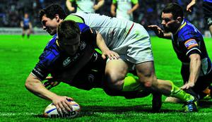 3 May 2013; Andrew Conway, Leinster, scores both his and his side's third try despite the tackle of Ross Jones, Ospreys. Celtic League 2012/13, Round 22, Leinster v Ospreys, RDS, Ballsbridge, Dublin. Picture credit: Barry Cregg / SPORTSFILE