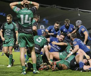 Leinster players celebrate after being awarded a late penalty try against Connacht.