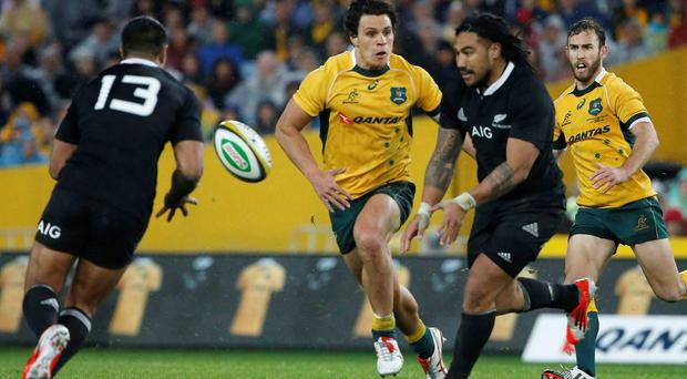 New Zealand's All Blacks centre Ma'a Nonu (C) offloads the ball to Malakai Fekitoa (L) during their Rugby Championship match against the Australia's Wallabies in Sydne