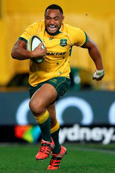 Australia's Sekope Kepu bursts clear for his second-half try
