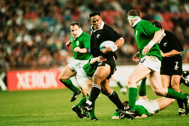 Jonah Lomu is tackled by Eric Elwood of Ireland during a 1995 Rugby World Cup match