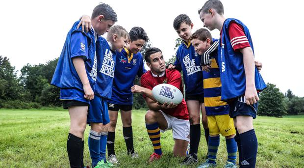 Students of Scoil Ide, Corbally (L-R) Stephen Kelly, Scott Grant, Liam O'Connell, Eoin McGurran, Jamie McMahon and Cian Costello with Conor Murray in Limerick yesterday