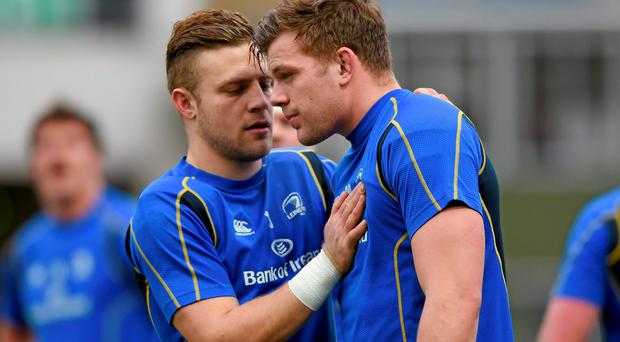 Ian Madigan chats with Jordi Murphy after getting the late call to replace Jennings. Above: Josh Van Der Flier also had to step up to the mark at the RDS last Saturday