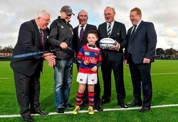 Clontarf U-9s Kealan Feeney and Ireland head coach Joe Schmidt were on hand to help launch Clontarf's new 4g pitch
