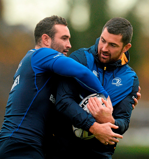 Dave Kearney tackles his brother Rob during training this week at Belfield, UCD