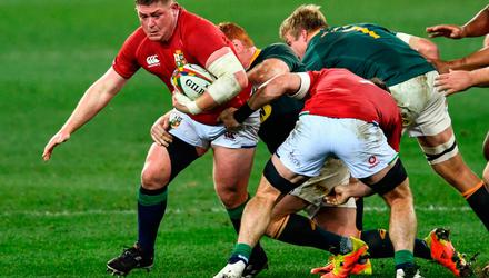 Tadhg Furlong of the British and Irish Lions, supported by team-mate Tom Curry, in action against Steven Kitshoff and Pieter-Steph du Toit of South Africa at Cape Town Stadium. Photo: Ashley Vlotman/Sportsfile