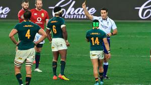 Cheslin Kolbe of South Africa is shown a yellow card by referee Ben O'Keeffe after a tackle on Conor Murray. Photo: David Rogers/Getty Images