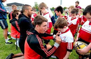 Ian Keatley and Simon Zebo signing t-shirts at one of last year's Summer Camps