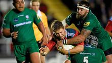 David Johnston, Munster, is tackled by Nic Rouse, 5, and Matt Parr, London Irish