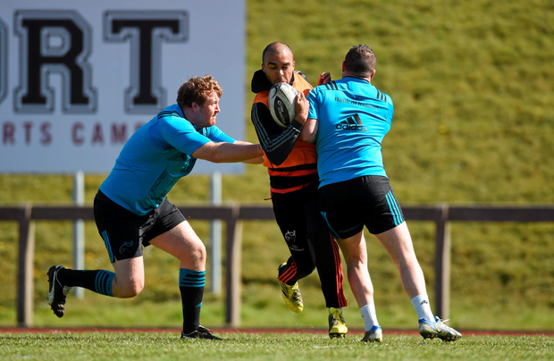 Munster's Simon Zebo in action against Dave Kilcoyne, right, and Stephen Archer during training at University of Limerick. Photo: Sportsfile