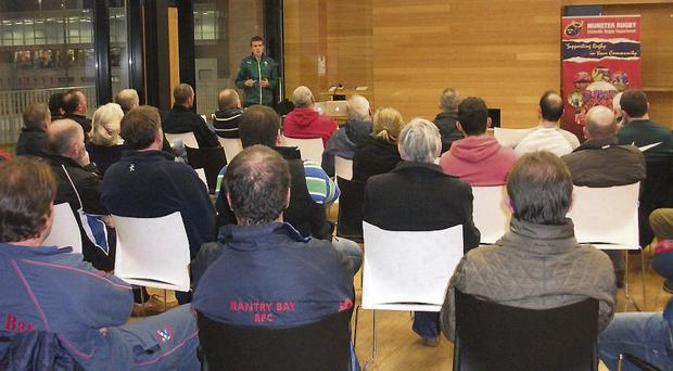 The audience listens to a speaker at the concussion seminar in UCC