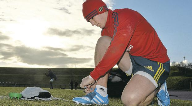 Ian Keatley ties his bootlaces before squad training ahead of the match against Perpignan