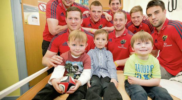 Munster players visited the ARK Paediatric Department of Limerick Regional Hospital in Dooradoyle during the week with players Felix Jones, Denis Hurley, Andrew Conway, James Downey, Johne Murphy, Ivan Dineen and Conor Murray pictured alongside Nathan Ahern, Graham Ahern and Evan O'Loughlin from Lahinch, Co. Clare ©INPHO/Morgan Treacy