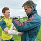 Munster's Cathal Sheridan gets some strapping applied by head of physiotherapy Anthony Coole before training in Limerick. Picture: Diarmuid Greene/SPORTSFILE