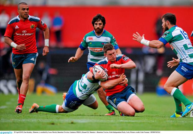 Ian Keatley is tackled by a Treviso player