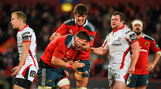 CJ Stander (left) and Donncha O'Callaghan celebrate moments before the final whistle of Munster's hard-fought victory over Ulster in November