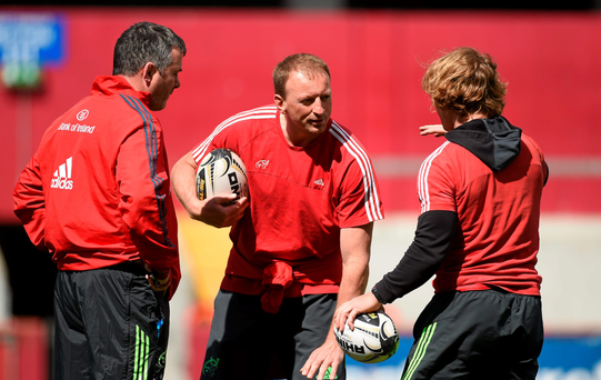 Munster head coach Anthony Foley, left, technical advisor Mick O'Driscoll, centre, and scrum coach Jerry Flannery in conversation