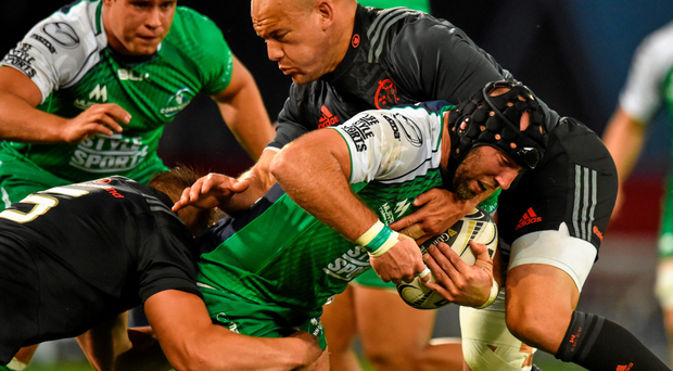 Connacht's John Muldoon is tackled by Munster duo Dave Foley and BJ Botha