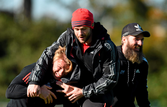 Munster scrum coach Jerry Flannery, left, strength and conditioning coach PJ Wilson, centre, and head of fitness Aled Walters share a joke before training this week