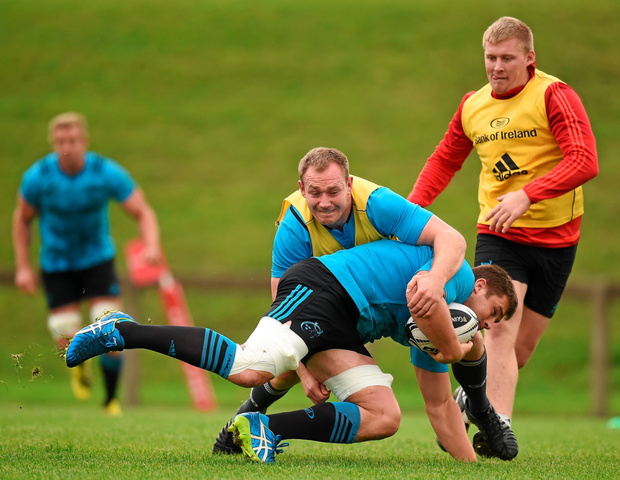 Munster's CJ Stander is tackled by Shane Buckley in training