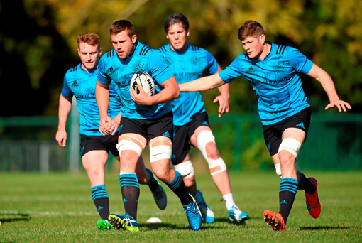 Munster's CJ Stander supported by team-mates Rory Scannell, Dave O'Callaghan and Jack O'Donoghue during squad training