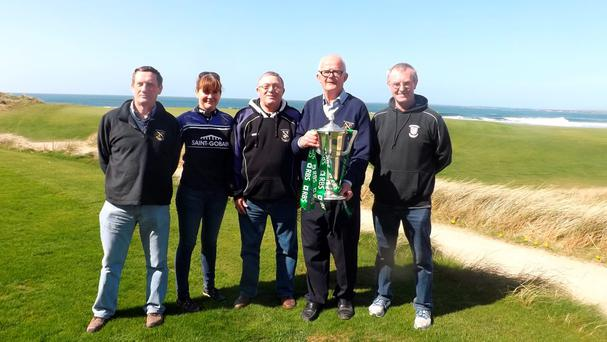 Club President David Glynn (holding the cup) pictured with members of the Kilrush Committee
