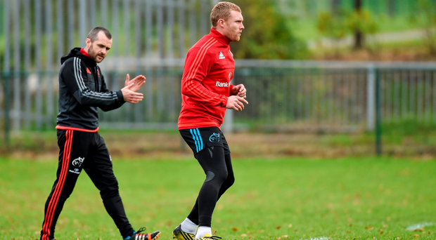Munster's Keith Earls with strength & conditioning coach PJ Wilson during squad training in Cork