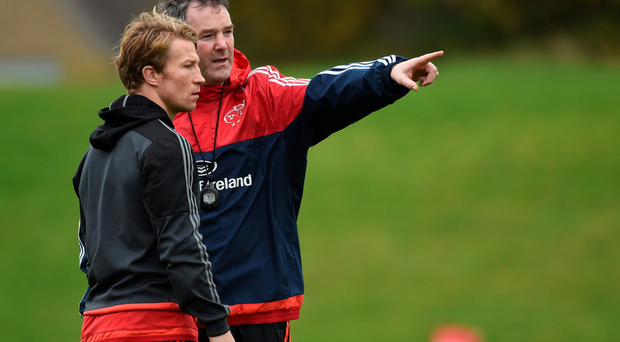 Munster head coach Anthony Foley in conversation with Jerry Flannery during training in Limerick