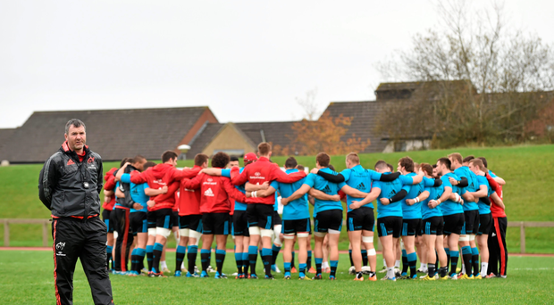Anthony Foley stands back as his Munster players share some strong words before training