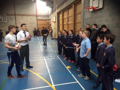Villiers TY students pass on their rugby knowledge to Milford National school pupils