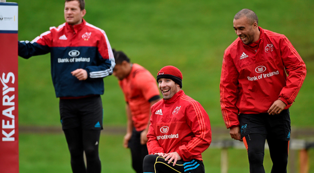 Denis Hurley, Tomas O'Leary and Simon Zebo go through their stretching routines in training Photo:Sportsfile