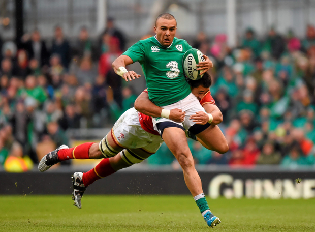Simon Zebo is tackled by Taulupe Faletau during Ireland's Six Nations clash with Wales last weekend (SPORTSFILE)
