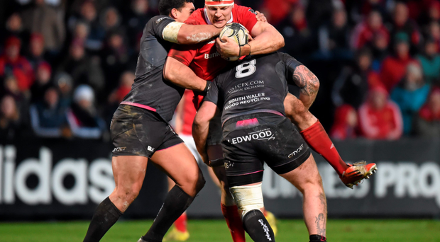 Munster's Robin Copeland is tackled by Ospreys duo Josh Matavesi, left, and Dan Baker during last weekend's Pro 12 clash at Irish Independent Park. Photo: Sportsfile