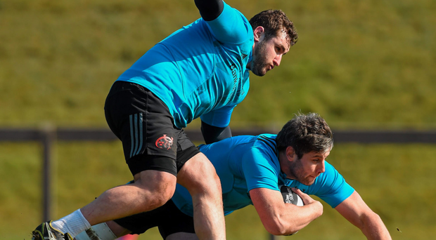 Munster's Dave O'Callaghan and James Cronin, left, in action during training in Limerick Photo: Sportsfile