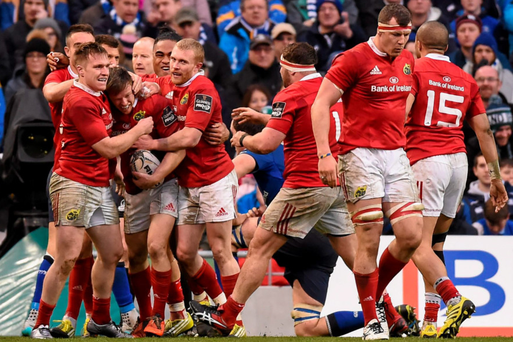 Munster's Johnny Holland is congratulated by team-mates after scoring a try against Leinster last weekend Photo: Sportsfile