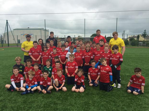 Jack O'Donoghue with youngsters at a Munster summer camp