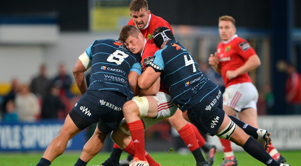 Munster's Jack O'Donoghue is tackled by Cardiff Blues' Nick Williams, left, and George Earle during his side's Pro12 defeat Photo: Piaras Ó Mídheach/Sportsfile