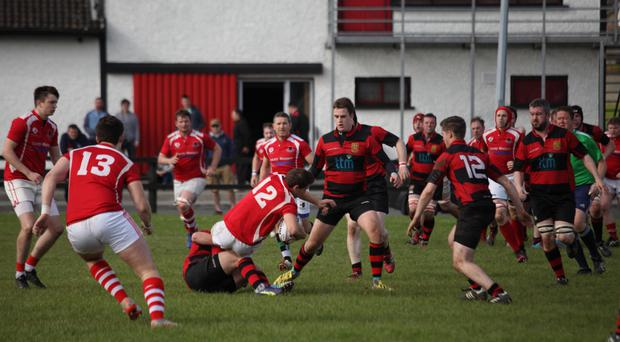 The Ennis RFC senior XV get their defensive line in order against Charleville RFC. Photo: Helen McQuillan