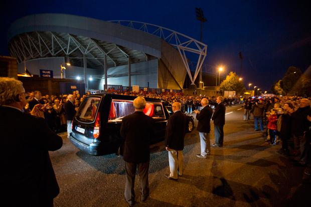 The hearse carrying Anthony Foley passes at Thomond Park, Limerick tonight Photo: Mark Condren
