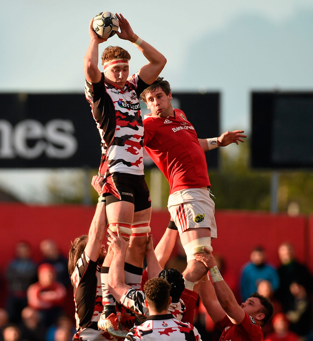 Jamie Ritchie, Edinburgh, wins possession in a lineout ahead of Dave O'Callaghan, Munster