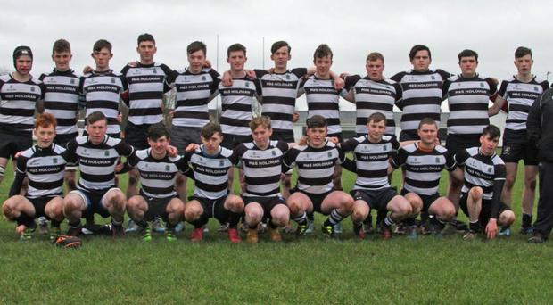 Thurles U-18s squad with their head coach, John Shaw, before they beat Thomond RFC recently