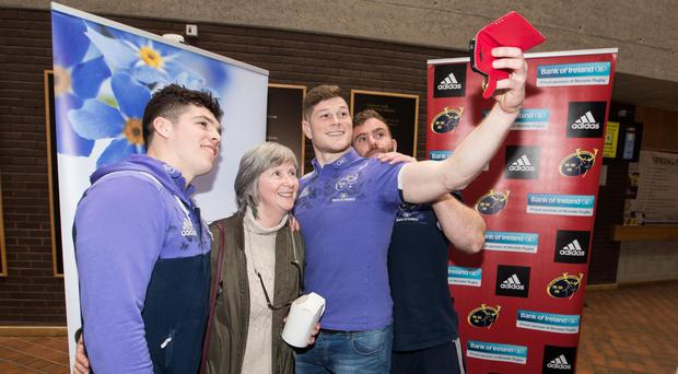 Jack O'Donoghue, Jaco Taute and Alex Wootton take photos at the University Of Limerick's Alzheimer's Tea Day. Photo: INPHO